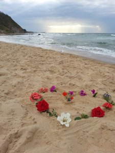 flower heart on the beach
